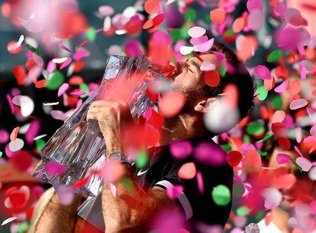 Mar 18, 2018; Indian Wells, CA, USA; Juan Martin Del Potro holds the championship trophy after defeating Roger Federer (not pictured) in the men's finals in the BNP Paribas Open at the Indian Wells Tennis Garden. Mandatory Credit: Jayne Kamin-Oncea-USA TODAY Sports