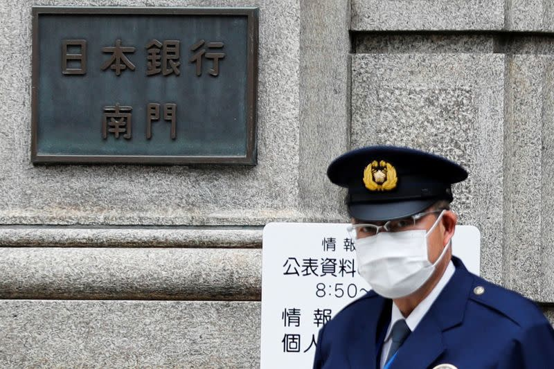 A policeman stands guard in front of the headquarters of Bank of Japan amid the coronavirus disease (COVID-19) outbreak in Tokyo
