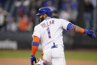 New York Mets' Jonathan Villar smiles after hitting driving in the winning run during the eighth inning against the Philadelphia Phillies in the first game of a baseball doubleheader Tuesday, April 13, 2021, in New York. The Mets won 4-3. (AP Photo/Frank Franklin II)