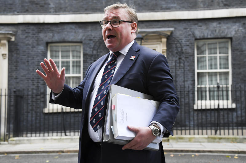 Mark Francois of the European Research Group (ERG) speaks to reporters as he arrives at 10 Downing Street, in London, Friday, Oct. 18, 2019. Britain's Parliament is set to vote Saturday on Prime Minister Boris Johnson's new deal with the European Union, a decisive moment in the prolonged bid to end the Brexit stalemate. Various scenarios may be put in motion by the vote. (AP Photo/Alberto Pezzali)