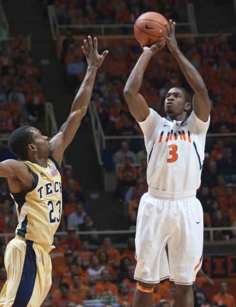 Georgia Tech Brandon Reed (23) defends Illinois' Brandon Paul (3) during the first half of an NCAA college basketball game in Champaign, Ill. Wednesday, Nov. 28, 2012. (AP Photo/Robert K. O'Daniell)