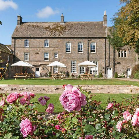 """<p>Located in the quaint village of Blanchland on the Northumberland and Durham border, the 18th century <a href=""""https://www.lordcrewearmsblanchland.co.uk/"""" rel=""""nofollow noopener"""" target=""""_blank"""" data-ylk=""""slk:Lord Crewe Arms"""" class=""""link rapid-noclick-resp"""">Lord Crewe Arms</a>'s garden looks out onto the pretty village square. Sit back and enjoy a G&T as you watch passersby. </p><p><a href=""""https://www.instagram.com/p/CLZqWr-AmIs/?utm_source=ig_embed&utm_campaign=loading"""" rel=""""nofollow noopener"""" target=""""_blank"""" data-ylk=""""slk:See the original post on Instagram"""" class=""""link rapid-noclick-resp"""">See the original post on Instagram</a></p>"""