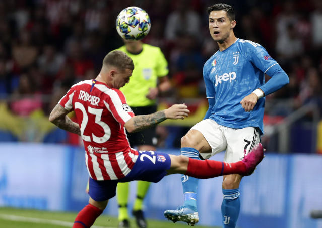 Juventus' Cristiano Ronaldo fights for the ball against Atletico Madrid's Kieran Trippier during the Champions League Group D soccer match between Atletico Madrid and Juventus at Wanda Metropolitano stadium in Madrid, Spain, Wednesday, Sept. 18, 2019. (AP Photo/Manu Fernandez)