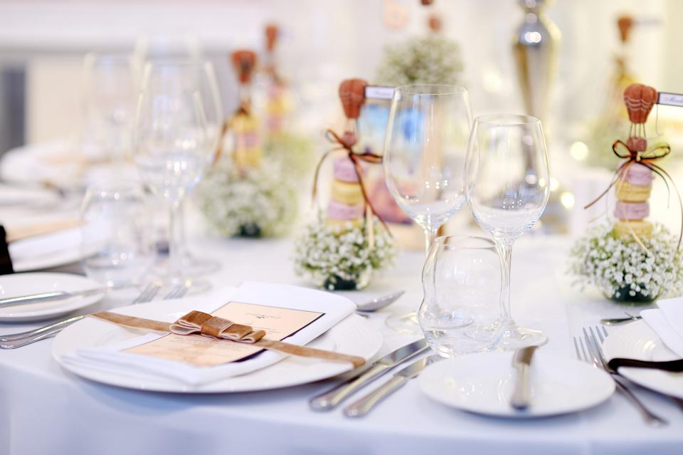 The bride and groom served different food depending on the guest's gender. [Photo: Getty]