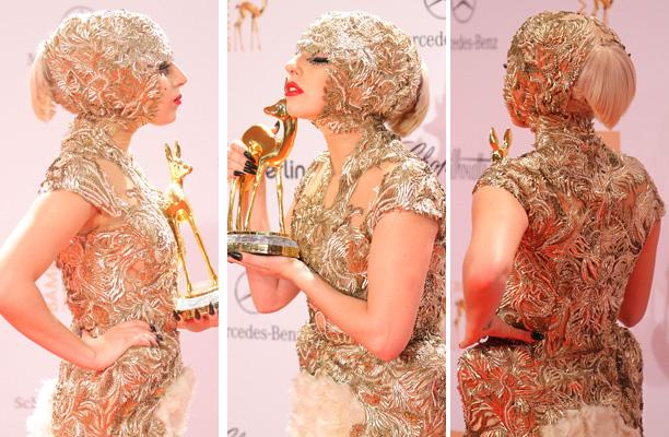 Lady Gaga poses in front of the winners board during the Bambi Award 2011