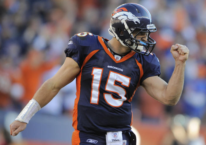 FILE - In this Dec. 18, 2011 file photo, Denver Broncos quarterback Tim Tebow (15) reacts after a touchdown run by Denver Broncos running back Lance Ball (35) against the New England Patriots in an NFL football game, in Denver. Tebow was traded to the New York Jets, Wednesday, March 21, 2012. (AP Photo/Jack Dempsey, File)