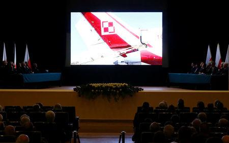 A movie is projected during a new Polish government commission statement on the seventh anniversary of the crash of the Polish government plane in Smolensk, Russia, that killed 96 people on board including late President Lech Kaczynski and his wife Maria, in Warsaw, Poland April 10, 2017. REUTERS/Kacper Pempel