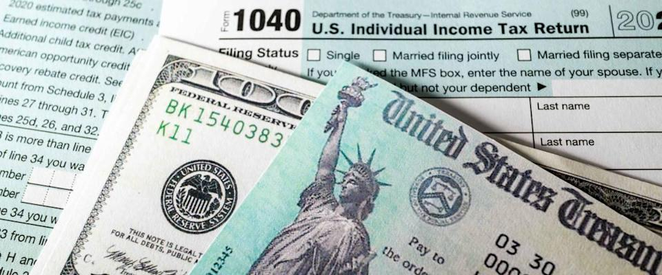 Stimulus economic tax return check and and 1040 Form.