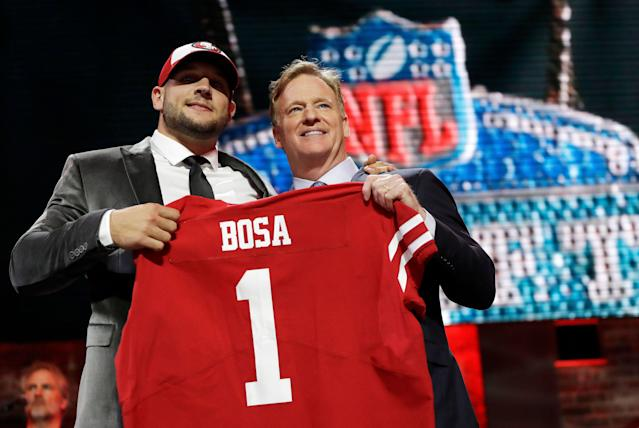 Ohio State defensive end Nick Bosa poses with NFL commissioner Roger Goodell after the San Francisco 49ers selected Bosa in the first round at the NFL football draft. (AP)