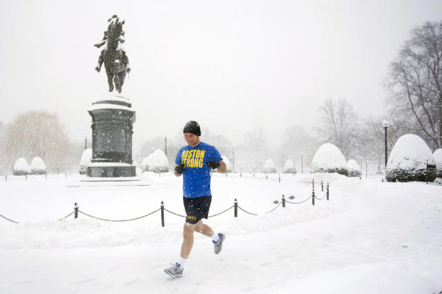 Man goes for a run in the Public Garden during a winter storm in Boston