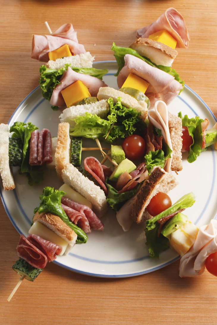 """<p>Sandwiches are way less boring when you put them on a stick! This calls for lunch meat, but you can easily swap in leftovers.</p><p>Get the recipe from <a href=""""https://www.delish.com/cooking/recipe-ideas/recipes/a52688/lunch-kebabs-recipe/"""" rel=""""nofollow noopener"""" target=""""_blank"""" data-ylk=""""slk:Delish"""" class=""""link rapid-noclick-resp"""">Delish</a>.</p>"""