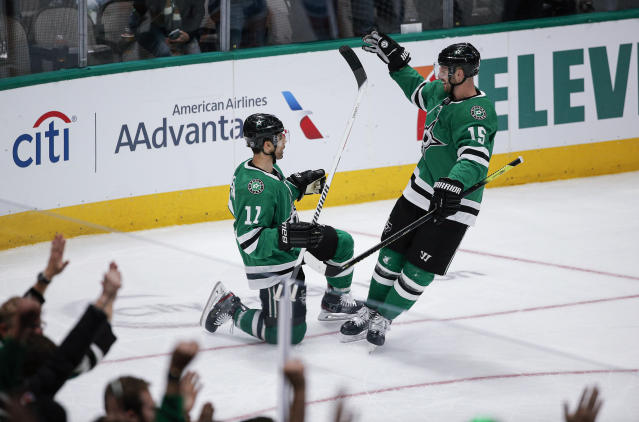 Dallas Stars forward Andrew Cogliano (11) is congratulated by forward Blake Comeau (15) after scoring a goal during the first period of the team's NHL hockey game against the New York Islanders on Saturday, Dec. 7, 2019, in Dallas. (AP Photo/Brandon Wade)