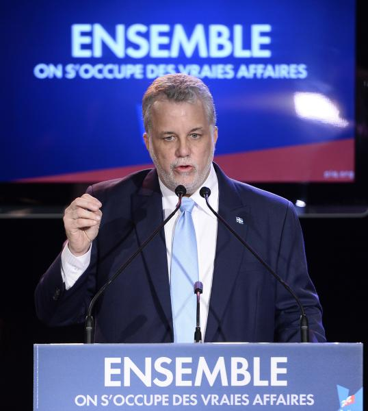 Quebec Liberal leader Philippe Couillard takes the stage after winning the provincial election Monday April 7, 2014 in St-Felicien, Quebec. (AP Photo/The Canadian Press, Jacques Boissinot)
