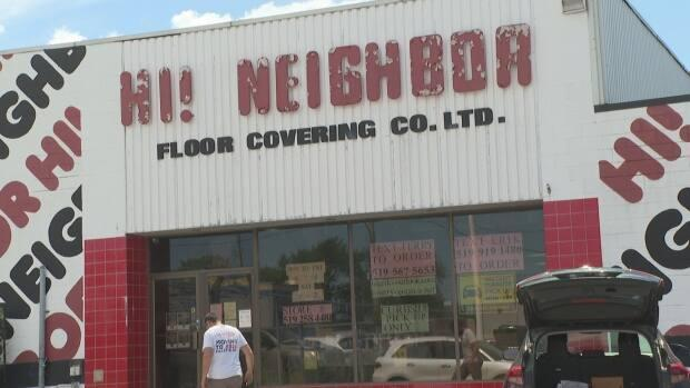 After more than 75 years of business in its original location, Hi! Neighbour Floor Covering Company is moving to a new location.  (Jacob Barker/CBC - image credit)