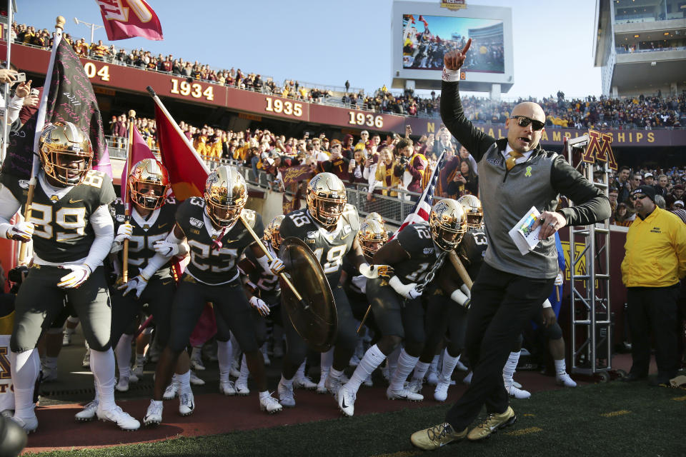Minnesota head coach P.J. Fleck leads him team on the field prior to an NCAA college football game against Maryland, Saturday, Oct. 26, 2019, in Minneapolis. Minnesota won 52-10. (AP Photo/Stacy Bengs)