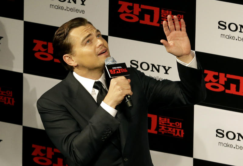 """Actor Leonardo DiCaprio waves to fans upon arriving for the premiere of his new film """"Django Unchained"""" in Seoul, South Korea, Thursday, March 7, 2013. DiCaprio is in Seoul to promote the film which is to be released in South Korea on March 21. (AP Photo/Lee Jin-man)"""