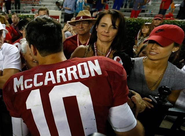 TUSCALOOSA, AL - SEPTEMBER 28: AJ McCarron #10 of the Alabama Crimson Tide is congratulated by his mother Dee Dee Bonner and girlfriend Katherine Webb after their 25-0 win over the Mississippi Rebels at Bryant-Denny Stadium on September 28, 2013 in Tuscaloosa, Alabama. (Photo by Kevin C. Cox/Getty Images)