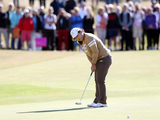 South Korea's Inbee Park putts on the 18th green during the Final day of the Women's British Open golf championship at the Royal Birkdale Golf Club, in Southport, England, Sunday, July 13, 2014. (AP Photo/Scott Heppell)