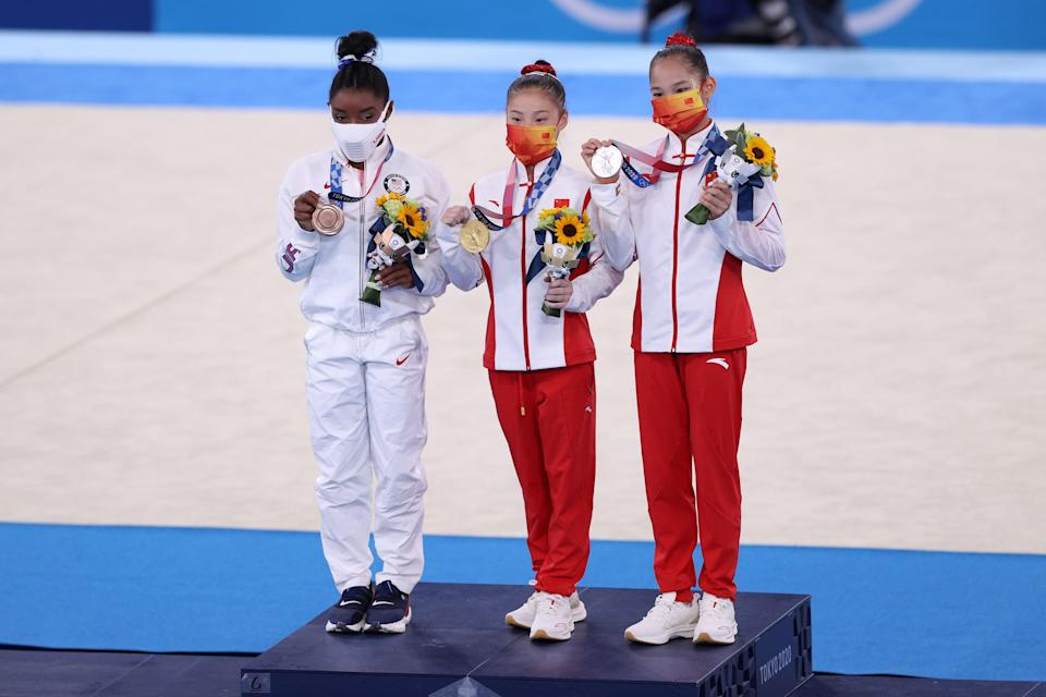 Silver medalist Xijing Tang of Team China, gold medalist Chenchen Guan of Team China and bronze medalist Simone Biles of Team United States (Getty)