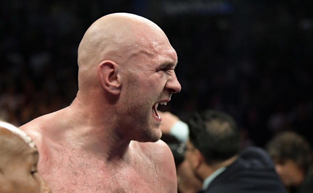 Tyson Fury, of England, yells after a WBC heavyweight championship boxing match against Deontay Wilder, Saturday, Dec. 1, 2018, in Los Angeles. The fight ended in a draw. (AP Photo/Mark J. Terrill)
