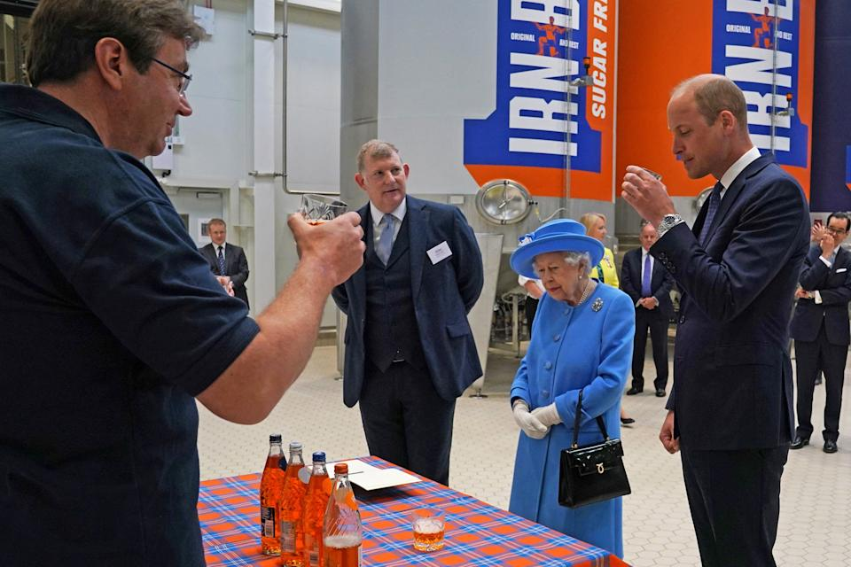 Britain's Prince William, Duke of Cambridge (R) samples Irn-Bru as he and Britain's Queen Elizabeth II  visit AG Barr's factory in Cumbernauld, east of Glasgow, where the Irn-Bru drink is manufactured on June 28, 2021. - The Queen is in Scotland for Royal Week where she will be undertaking a range of engagements celebrating community, innovation and history. (Photo by Andrew Milligan / POOL / AFP) (Photo by ANDREW MILLIGAN/POOL/AFP via Getty Images)