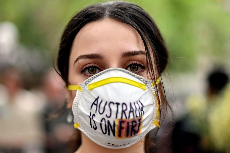 A demonstrator with a mask attends a climate protest rally in Sydney on December 11, 2019. Source: Getty