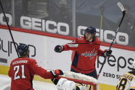 Washington Capitals left wing Carl Hagelin (62) celebrates his goal with right wing Garnet Hathaway (21) during the second period of an NHL hockey game against the Boston Bruins, Tuesday, May 11, 2021, in Washington. (AP Photo/Nick Wass)