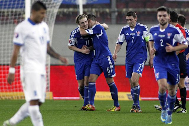 Faroe Island's Joan Edmundsson (C) celebrates with his teammates after scoring a goal against Greece in their Euro 2016 qualifyier in Piraeus, near Athens, on November 14, 2014 (AFP Photo/Angelos Tzortzinis)