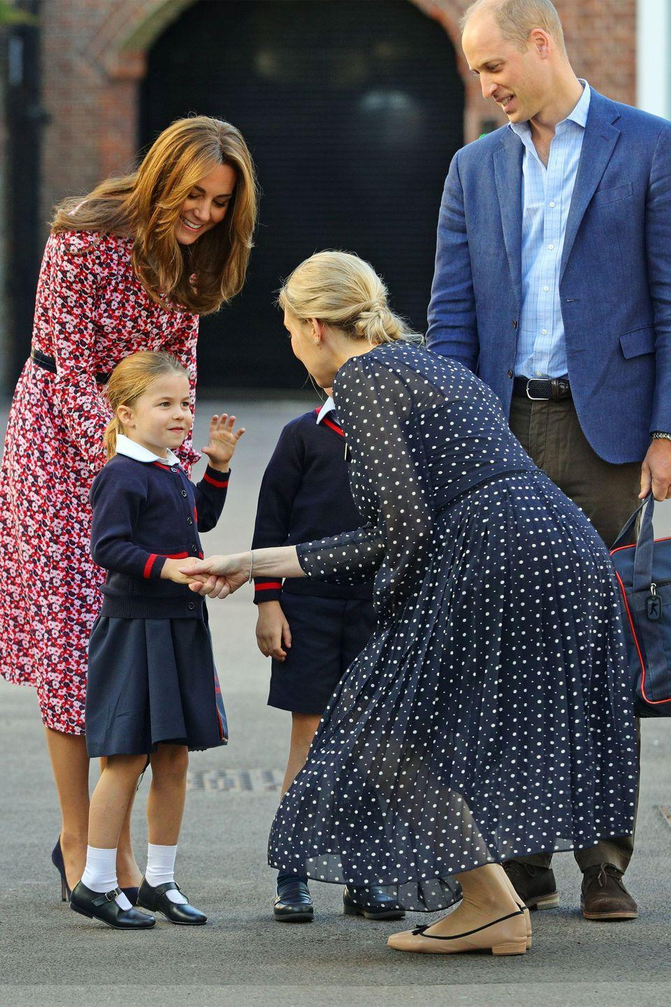 <p>Prince William and Kate watch as Princess Charlotte makes introductions.</p>