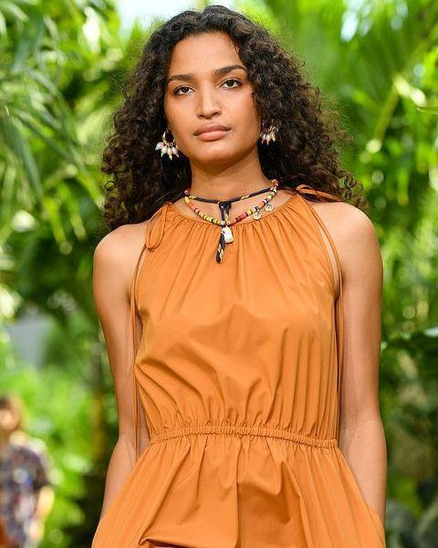 """<p>Prepare to see the imaginative hues sparked by quarantine experimentation give way to natural shades, which have handily dominated this year's fashion week. """"I predict that we are going see a lot of sandy and cinnamon browns, and overall more naturals and low-maintenance shades,"""" says Kandasamy. """"For a lot of clients, this has been a positive reset and they want to embrace their natural hair color or stay as close to their natural color as possible.""""</p><p><a href=""""https://www.instagram.com/p/CFGxEWgFJqK/"""" rel=""""nofollow noopener"""" target=""""_blank"""" data-ylk=""""slk:See the original post on Instagram"""" class=""""link rapid-noclick-resp"""">See the original post on Instagram</a></p>"""