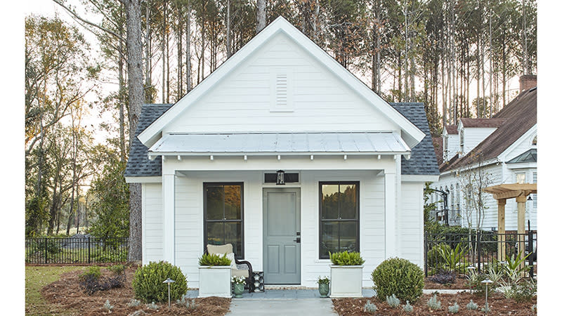 """<p>These guest quarters are the cozy counterpart to one of our favorite modern farmhouse plans, <a href=""""https://houseplans.southernliving.com/plans/SL1979"""" rel=""""nofollow noopener"""" target=""""_blank"""" data-ylk=""""slk:Whiteside Farm (SL-1979)."""" class=""""link rapid-noclick-resp"""">Whiteside Farm (SL-1979).</a> The cottage's features mirror those of the main home with a peaked gable, white siding, metal roof, and inviting front porch.</p> <p>1 bedroom, 1 bath</p> <p>430 square feet</p> <p>See plan: <a href=""""https://houseplans.southernliving.com/plans/SL1980"""" rel=""""nofollow noopener"""" target=""""_blank"""" data-ylk=""""slk:Whiteside Cottage (SL-1980)"""" class=""""link rapid-noclick-resp"""">Whiteside Cottage (SL-1980)</a></p>"""