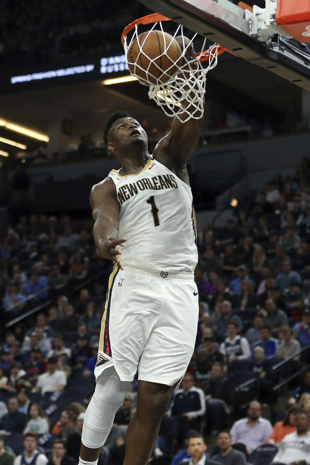 New Orleans Pelicans' Zion Williamson dunks in the second half of an NBA basketball game against the Minnesota Timberwolves, Sunday, March 8, 2020, in Minneapolis. (AP Photo/Stacy Bengs)