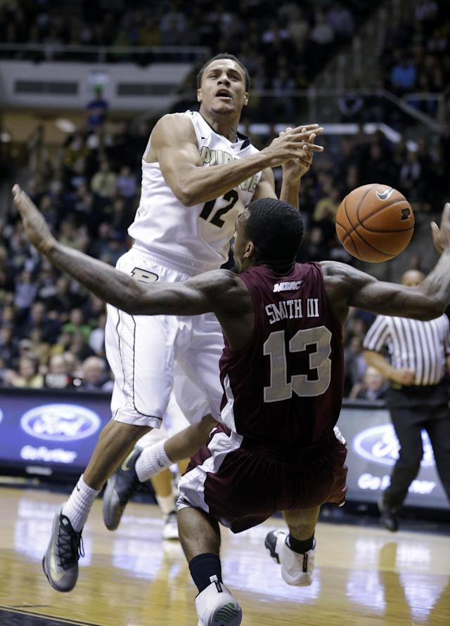 Purdue guard Bryson Scott is fouled by Maryland-Eastern Shore guard Issac Smith III on a drive into the lane in the first half of an NCAA college basketball game in West Lafayette, Ind., Tuesday, Dec. 17, 2013. (AP Photo/Michael Conroy)