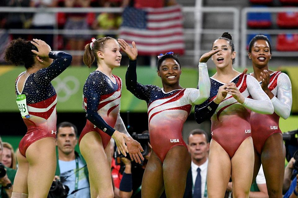 """<p><em>Laurie Hernandez, Madison Kocian, Simone Biles, Aly Raisman, and Gabby Douglas</em></p><p>Fun fact: <a href=""""https://www.cosmopolitan.com/style-beauty/fashion/a62586/olympic-leotard-facts/"""" rel=""""nofollow noopener"""" target=""""_blank"""" data-ylk=""""slk:it took two years"""" class=""""link rapid-noclick-resp"""">it took two years</a> to design and produce the leotards in 2016.</p>"""