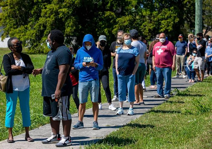 People wait in line to get vaccinated at the FEMA Florida City vaccination site at the Florida City Youth Center on Sunday, March 7, 2021.