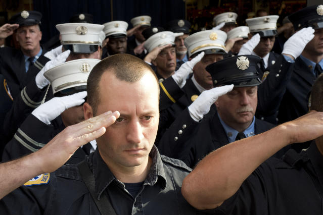 <p>New York City firefighters with Ladder 10 Engine 10 firehouse salute during a moment of silence, Monday, Sept. 11, 2017, at the World Trade Center in New York. Thousands of 9/11 victims' relatives, survivors, rescuers and others gathered Monday at the World Trade Center to remember the deadliest terror attack on American soil. During the attacks of Sept. 11, 2001, 343 firefighters were killed. (AP Photo/Mark Lennihan) </p>