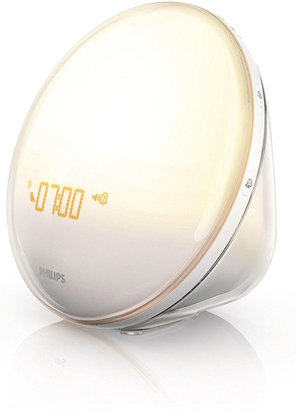 <p>This <span>Philips Wake-Up Light Alarm Clock With Colored Sunrise Simulation</span> ($140) lets him wake up with the sun, even if it's raining.</p>