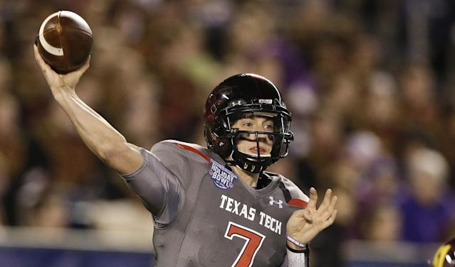 Texas Tech quarterback Davis Webb throws a pass during his record setting first half against Arizona State during the Holiday Bowl NCAA college football football game Monday, Dec. 30, 2013, in San Diego. Webb threw four touchdown passes and 301 yards in the first half. (AP Photo/Gregory Bull)
