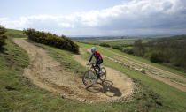 British Olympic hopeful Liam Killen poses for photographs during a test cycle on part of the Hadleigh farm Olympic mountain bike venue, Hadleigh, eastern England, April 4, 2012. REUTERS/Paul Hackett