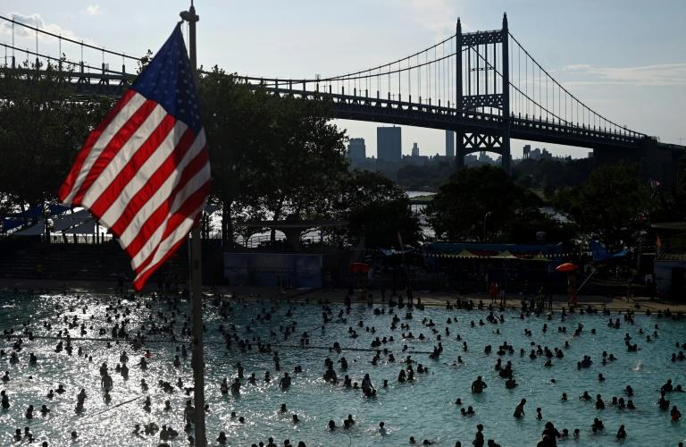 New Yorkers, pictured at the Astoria Pool in Queens on July 20, 2019, heeded warnings to keep cool and hydrated (AFP Photo/Johannes EISELE)