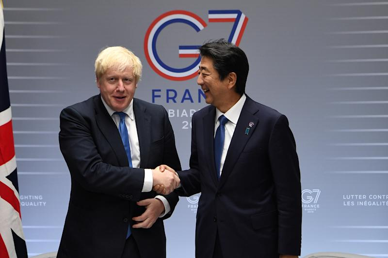 Britain's Prime Minister Boris Johnson meets with Prime Minister of Japan Shinzo Abe on day three of the G7 Summit in Biarritz, France, August 26, 2019. Andrew Parsons/Pool via REUTERS