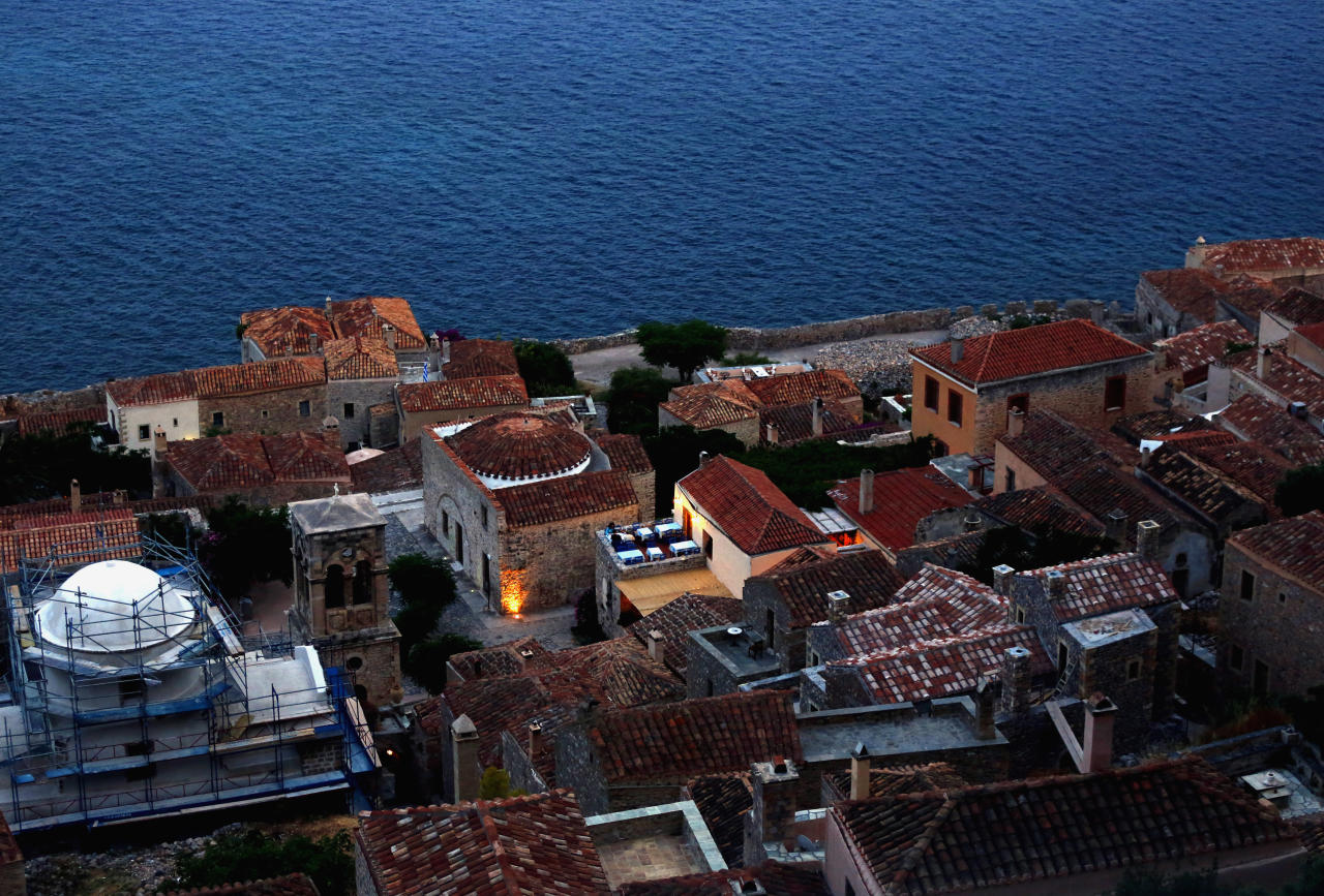 Foreign tourists eat on a restaurant terrace in the medieval castle of Monemvasia Yannis Behrakis / Reuters
