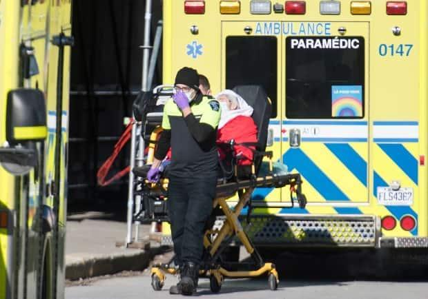 Paramedics transfer a person from an ambulance into Verdun hospital in Montreal, Tuesday, December 29, 2020. Quebec was one of the worst hit provinces in Canada.