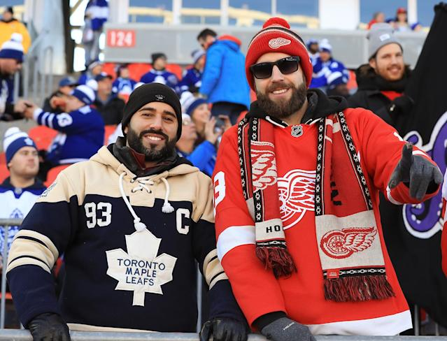 <p>A Leafs fan and a Wings fan in the stands. (Getty) </p>
