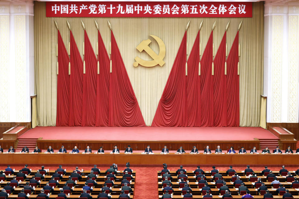 "In this photo released by Xinhua News Agency, Chinese President Xi Jinping, center, also general secretary of the Communist Party of China (CPC) Central Committee, leads other Chinese leaders attending the fifth plenary session of the 19th Central Committee of the Communist Party of China (CPC) in Beijing, China on Oct. 29, 2020. China's leaders are vowing to make their country a self-reliant ""technology power"" after a meeting to draft a development blueprint for the state-dominated economy over the next five years. (Liu Bin/Xinhua via AP)"
