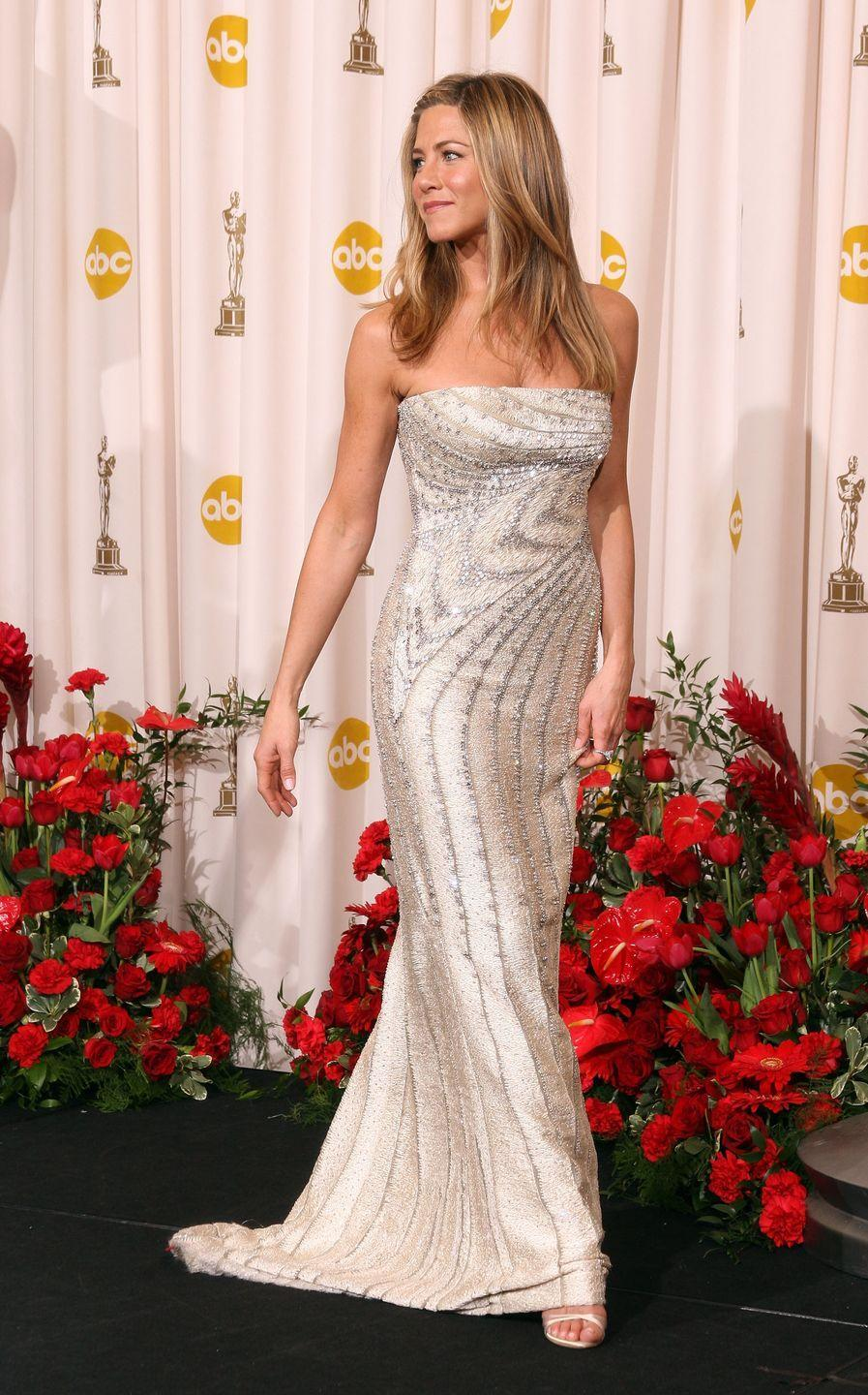 <p>Jen has never been nominated for an Oscar, but she always gets an invite. I'm not complaining because her style choices are impeccable, including this dazzling silver number.<br></p>