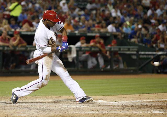 Texas Rangers' Elvis Andrus hits an RBI single against the Los Angeles Angels during the seventh inning of a baseball game, Tuesday, July 30, 2013, in Arlington, Texas. (AP Photo/Jim Cowsert)