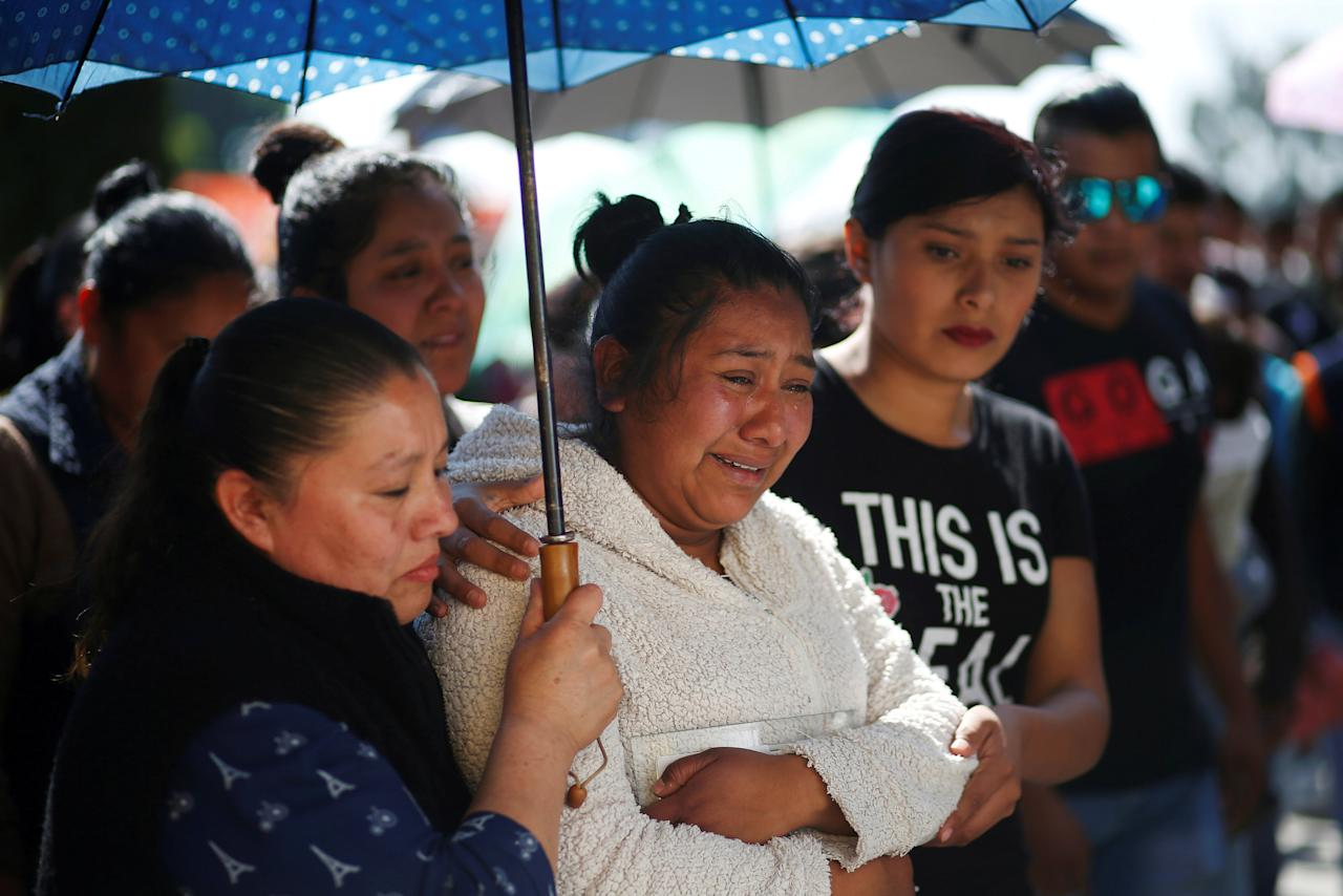 Residents react after a mass for their relative who died during the explosion of a fuel pipeline ruptured by oil thieves, in the municipality of Tlahuelilpan, state of Hidalgo, Mexico January 22, 2019. REUTERS/Mohammed Salem     TPX IMAGES OF THE DAY