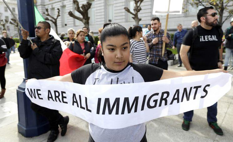 Delilah Gutierrez, 10, holds a sign during a protest against President Donald Trump's efforts to crack down on immigration, Feb. 16, 2017, in San Francisco. (Photo: Marcio Jose Sanchez/AP Photo)