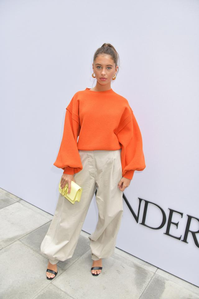 We're still a few weeks away from the official arrival of all things scary, but with PSLs taking over, Iris Law appeared to get a jump-start on October fashion with this top. The pumpkin-inspired shade of orange featured exaggerated bell sleeves, and she paired it with loose pants and heels.